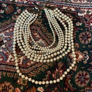 Multi strands of pearls.